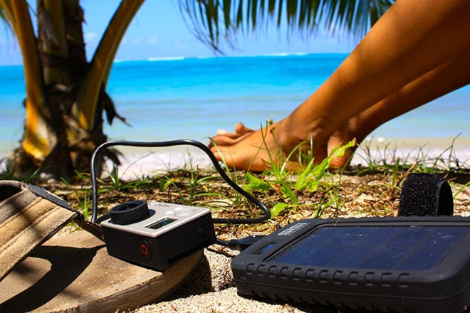 Charging our GoPro on Vaiula Beach, Samoa