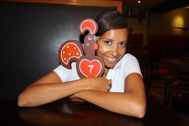 Kia hugging a Nando's restaurant sign how to save for travel