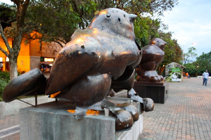 Botero's birds: A deformed sculpture sits next to a newer, perfectly-formed counterpart, representing the two stories of Medellin