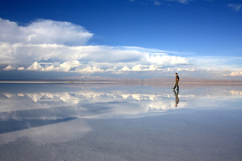 peter walking on wet salar de uyuni