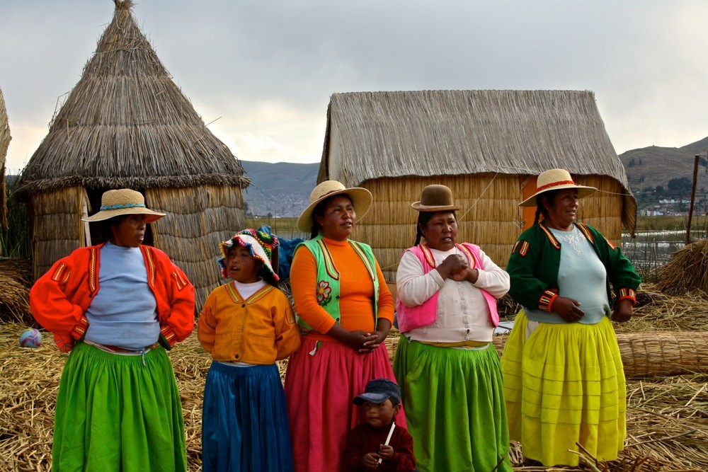 A local welcome on a Uros floating island, Peru