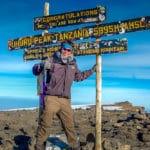 Peter on the summit of Mount Kilimanjaro in Tanzania