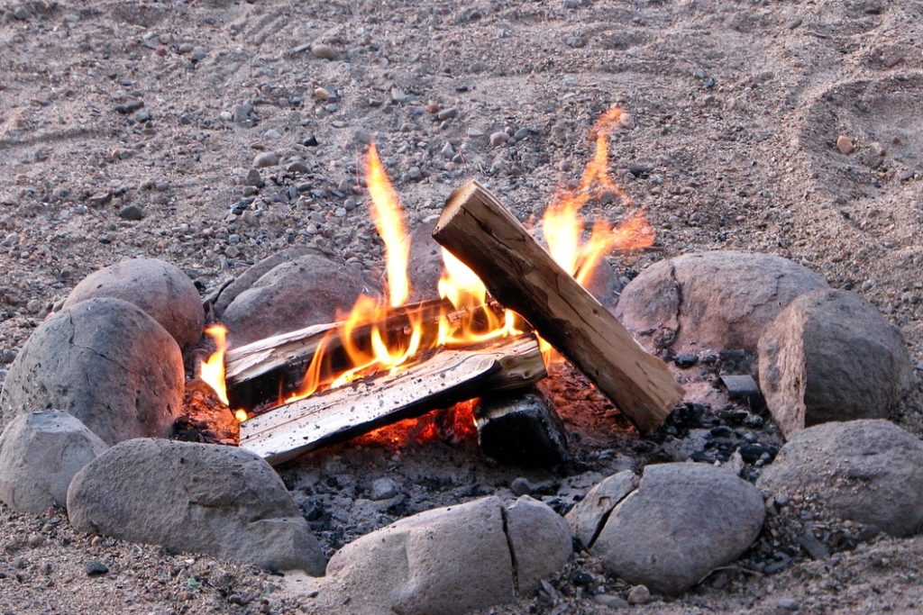 Using dry wood to build a campfire