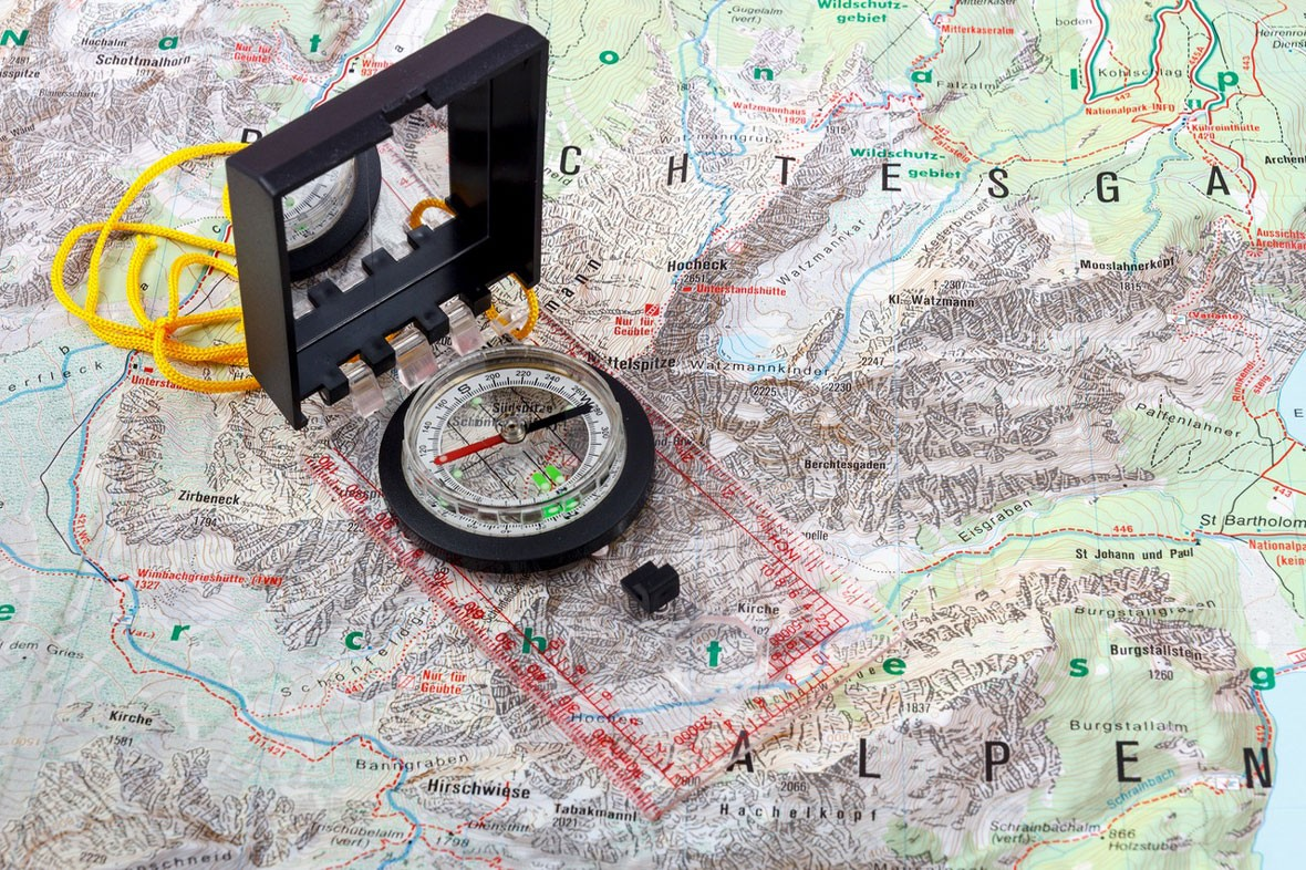 A map and compass forming part of the ultimate camping checklist