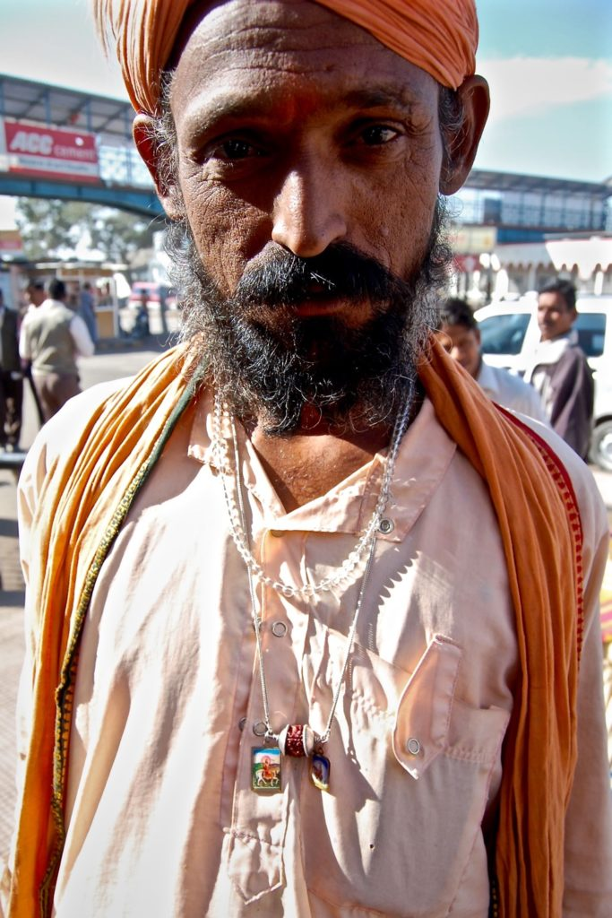 Religious Indian man, photographing local people