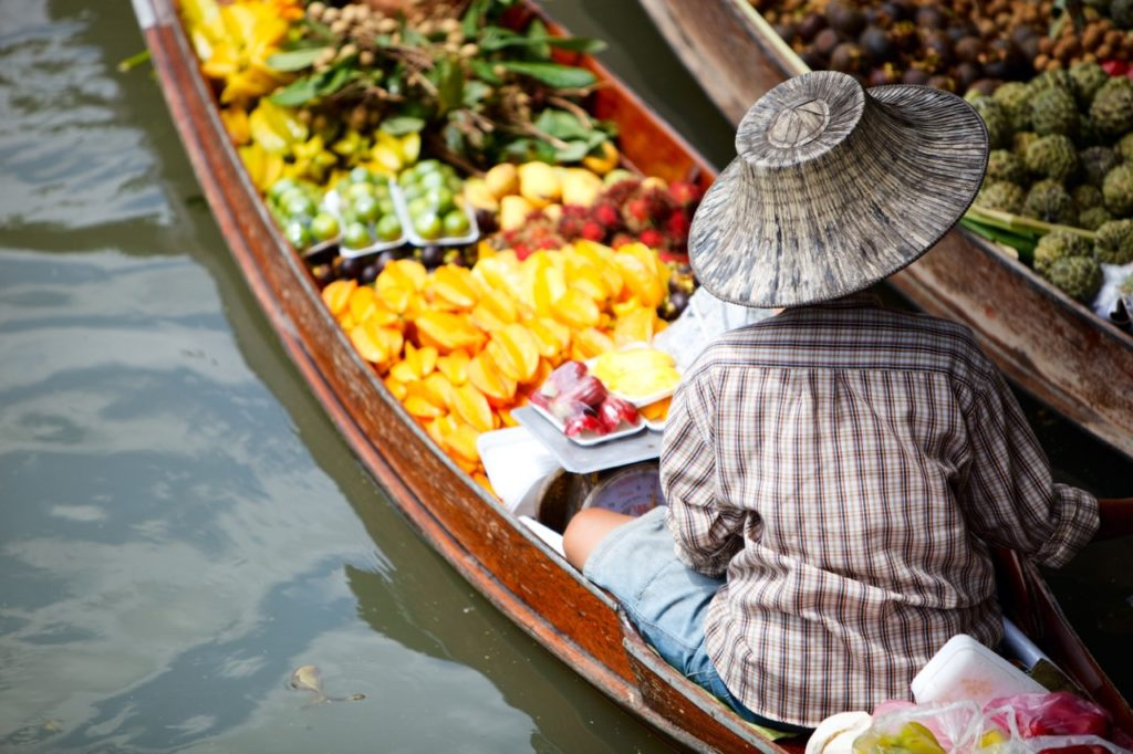 travel skills: bartering with woman in boat
