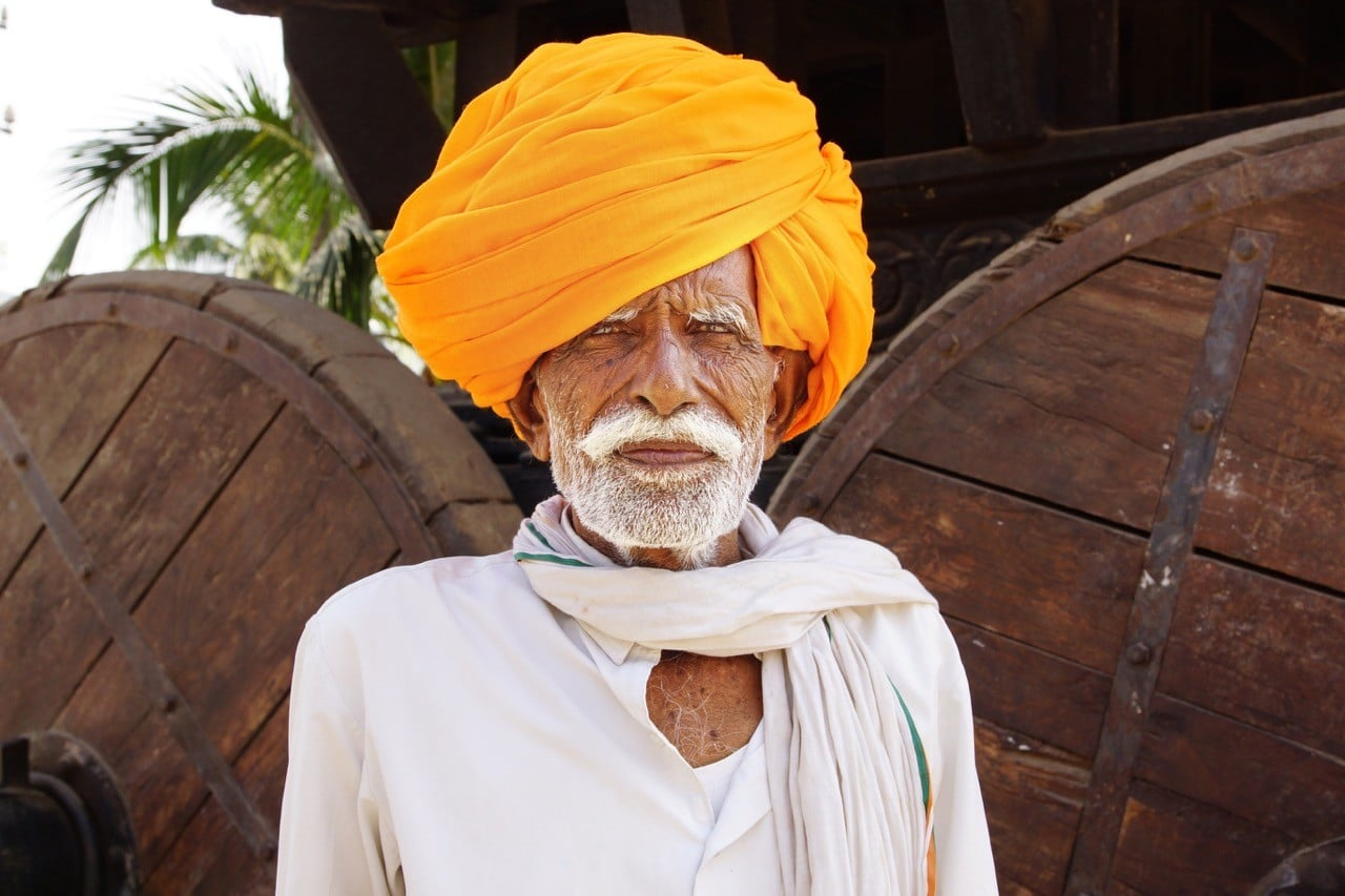 travel skills: old Indian man in yellow turban