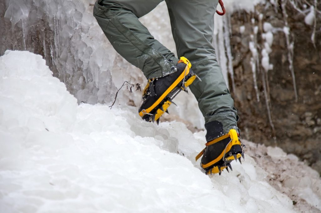 Man with crampons while winter hiking