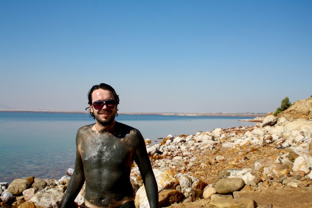 Peter covered in mud at the Dead Sea