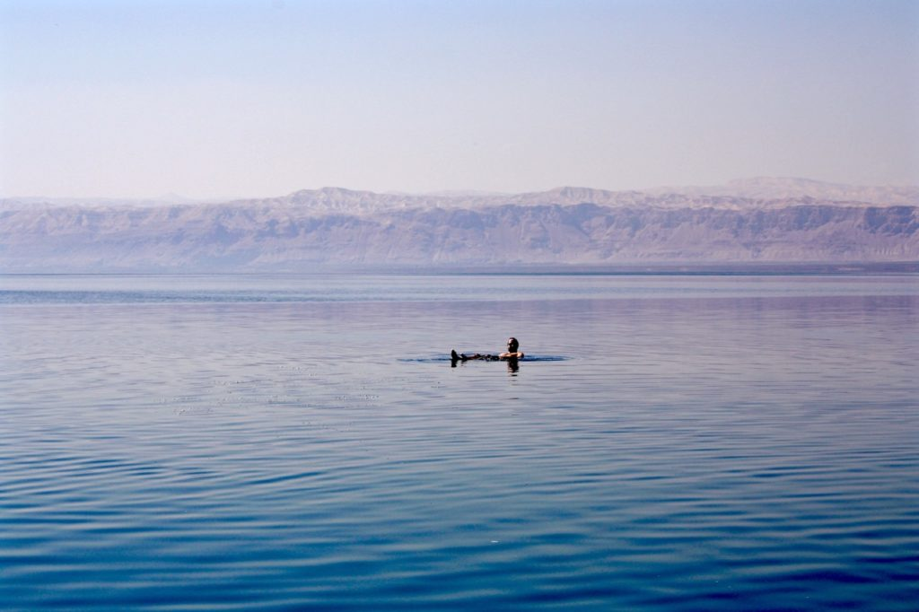 Peter floats on the surface of the Dead Sea