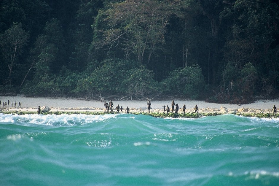 Sentinelis lined up on the shore of North Sentinel Island, ready to fight off visitors