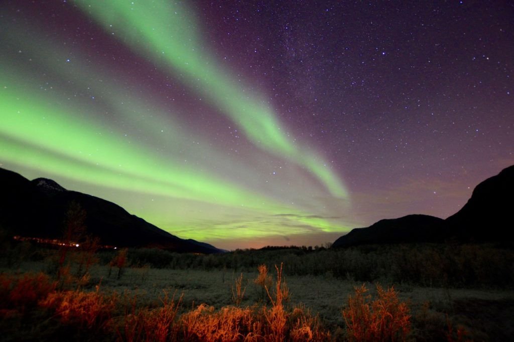 a photo taken while chasing the northern lights in tromso