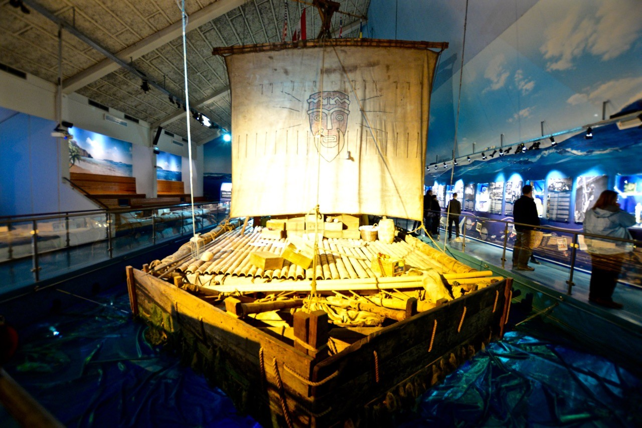 Kon Tiki raft set amid muted light at the Museum