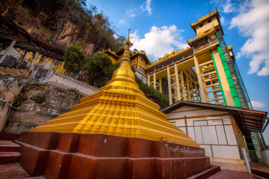 a pagoda at the entrance of the Pindaya Caves