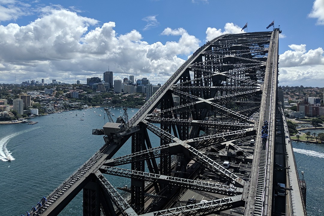 Climbers on the Sydney Bridge Climb are clipped on to the bridge at all times