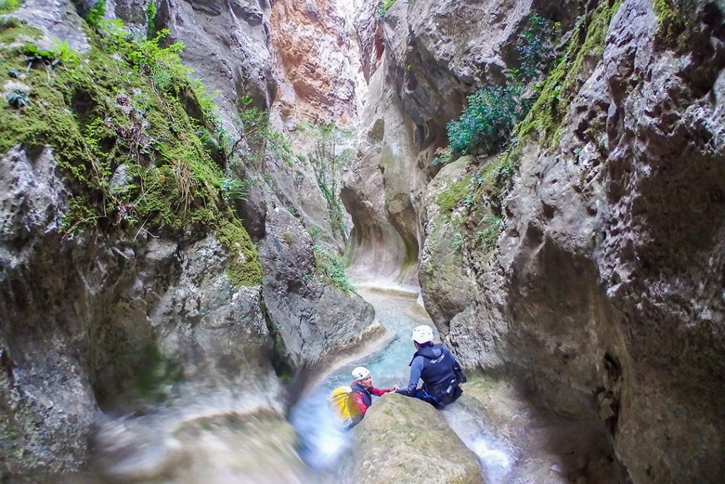 Jumping from a ledge in Hell's Canyon in Catalonia
