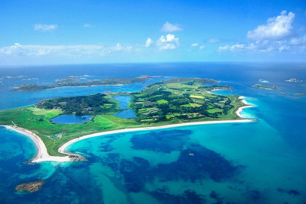 The incongruously blue waters of the Scilly Isles