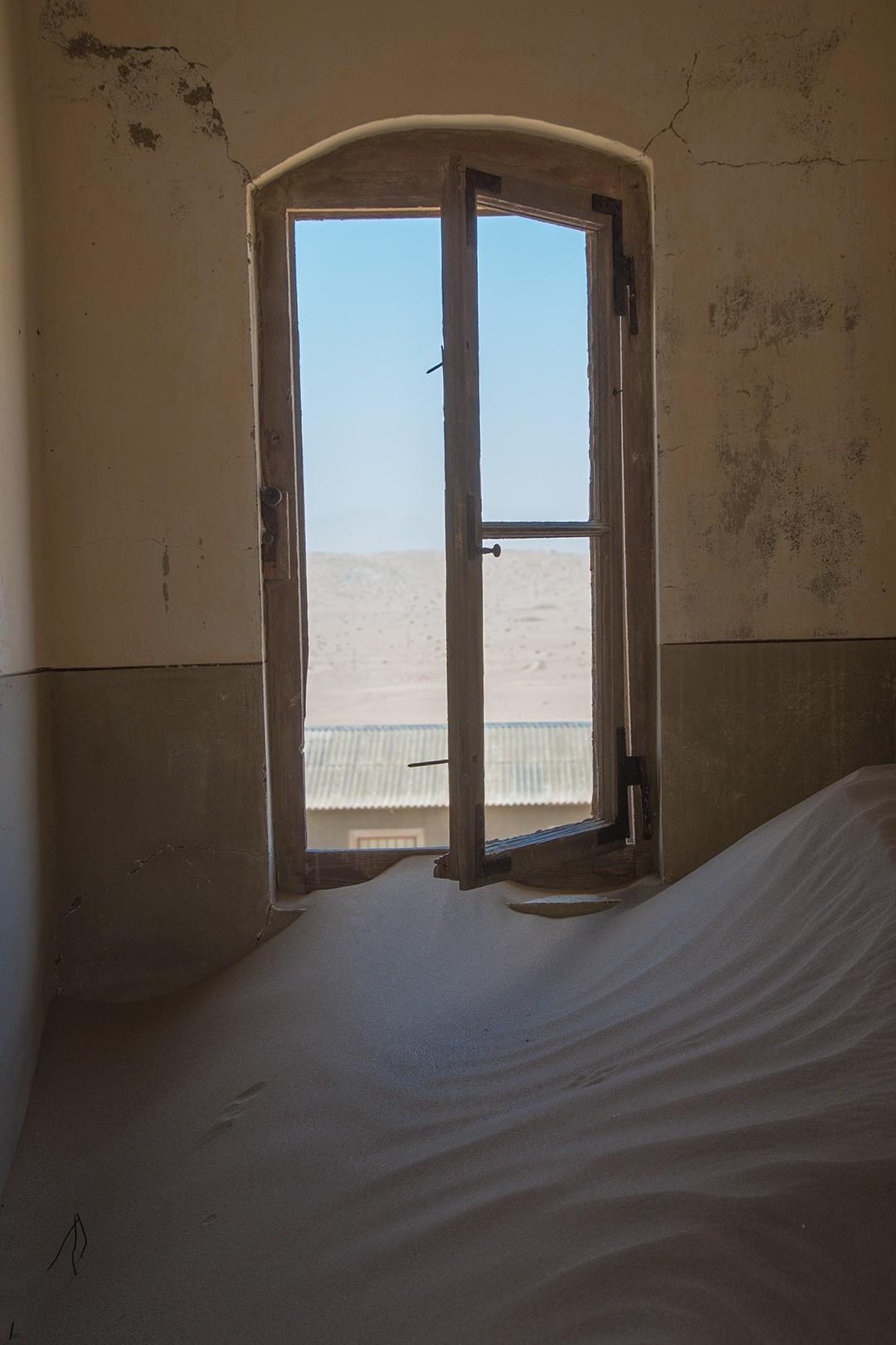 window frame at kolmanskop ghost town in namibia