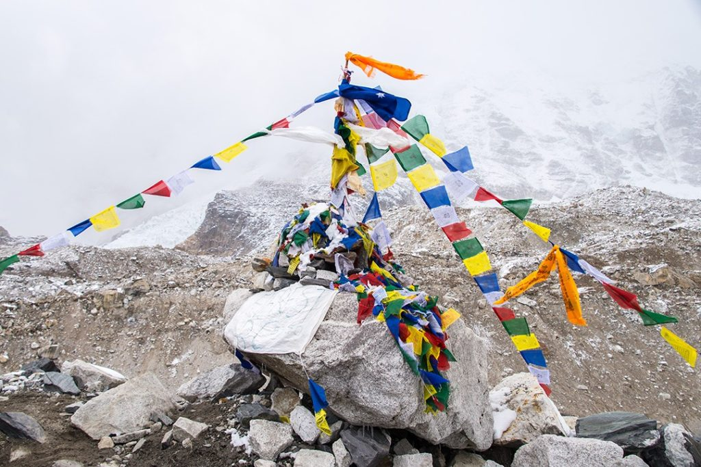 The cairn bedecked with prayer flags at EBC at the end of the Everest base camp trek