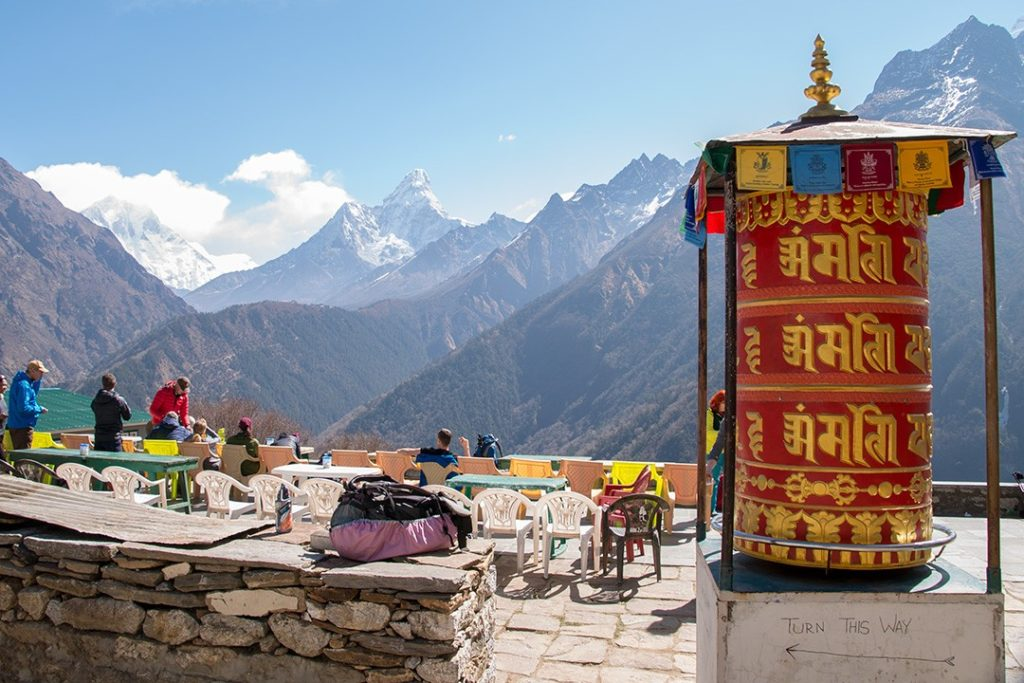 Drinking tea with views of Ama Dablam along the  Everest base camp trek