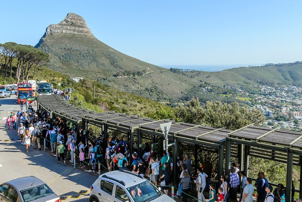 crowds wait for the cable car at table mountain