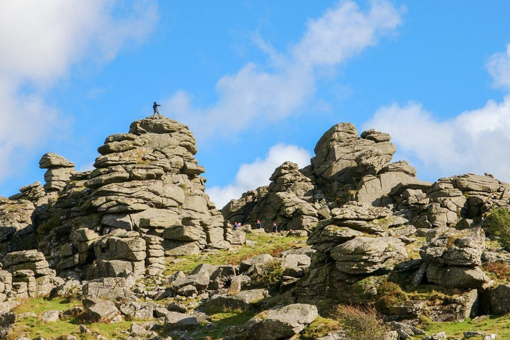 Rock climbers on Hound Tor one of the best hikes in Dartmoor National Park