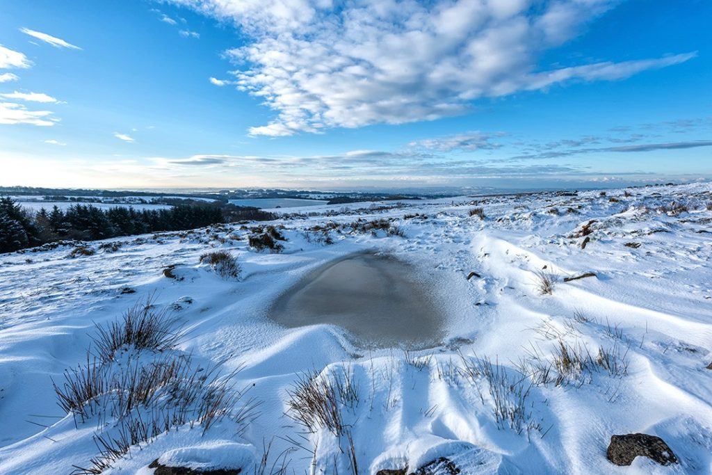 A frozen pond on Anglezarke Moor in Lancashire is one of the best outdoor destinations in Britain