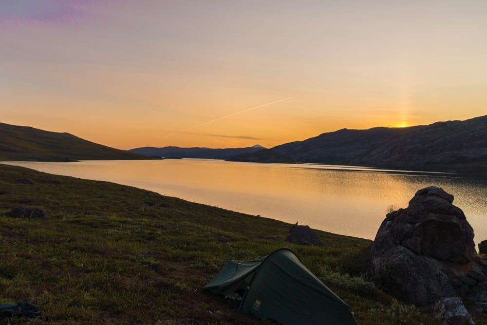 Camping alongside the Amitsorsuaq Lake while trekking the arctic circle trail
