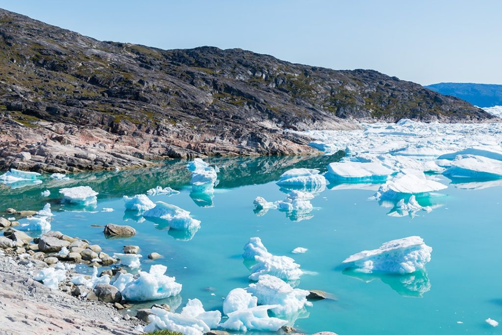 Hiking around Ilulissat icebergs in the bay
