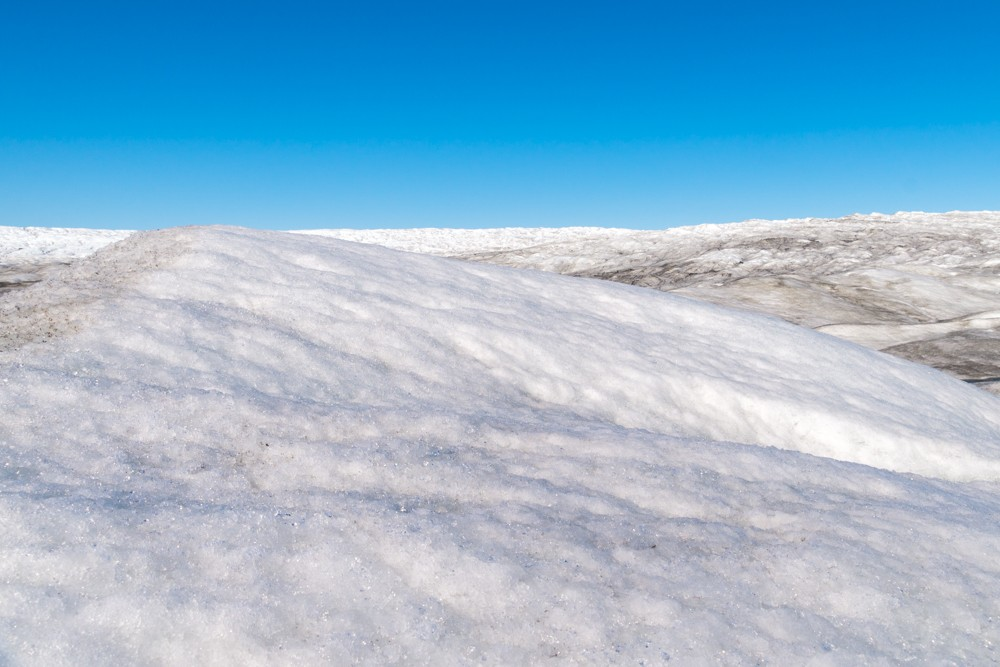 huge ice piles seen while visiting the Greenland ice sheet and Russell Glacier