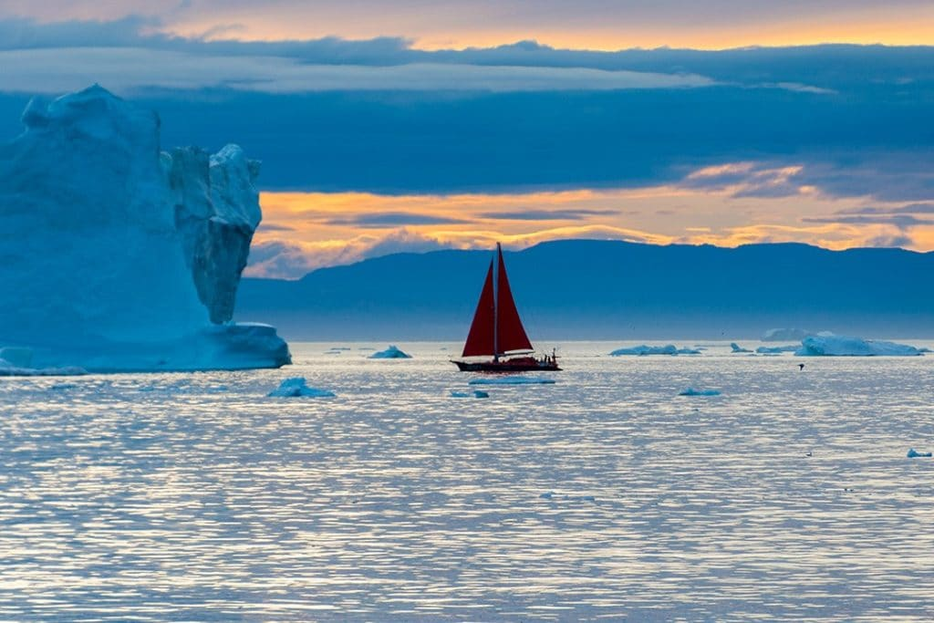 midnight sun iceberg sightseeing ilulissat sailboat