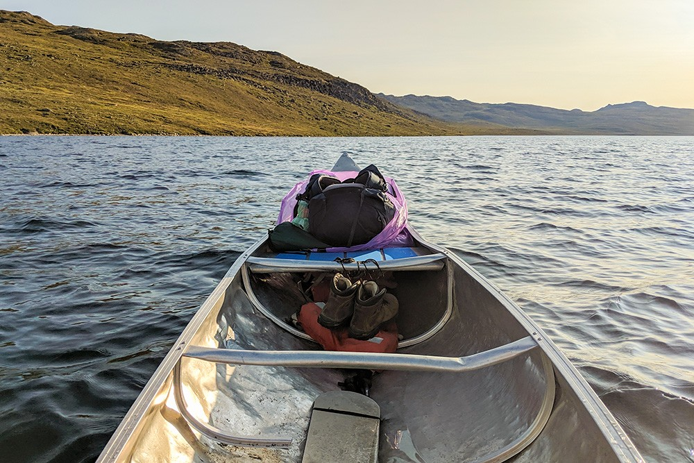 Canoeing along Amitsorsuaq Lake while trekking the arctic circle trail
