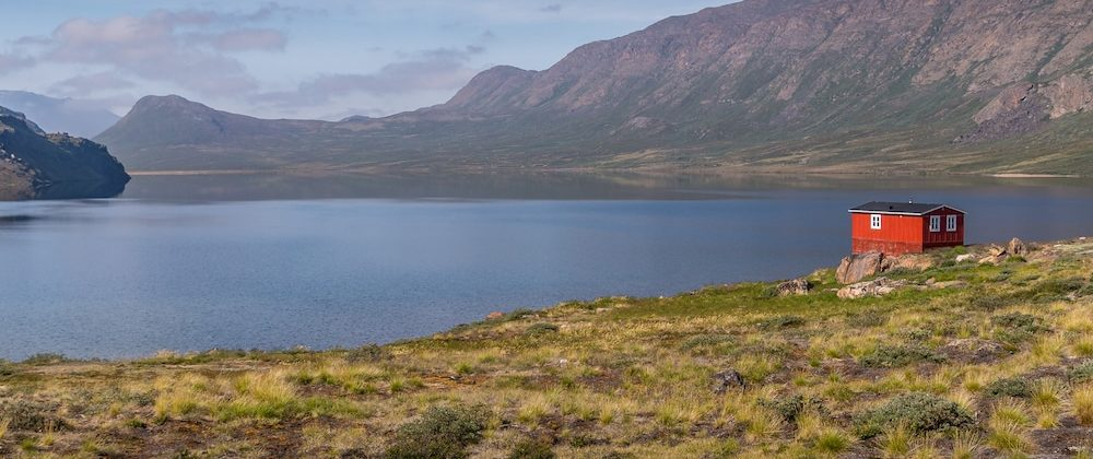 trekking the arctic circle trail lead image with hut and lake