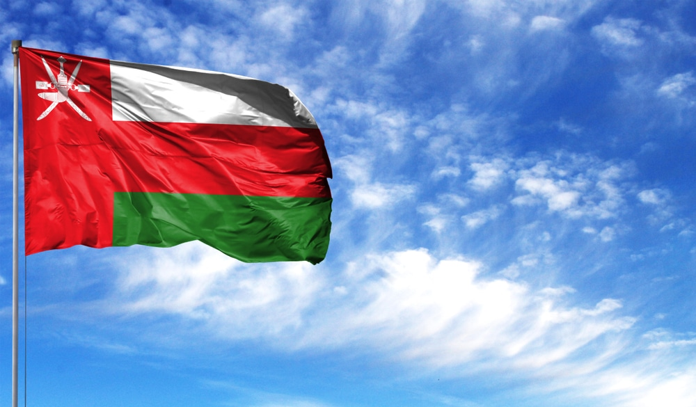 Oman's flag contains the national emblem