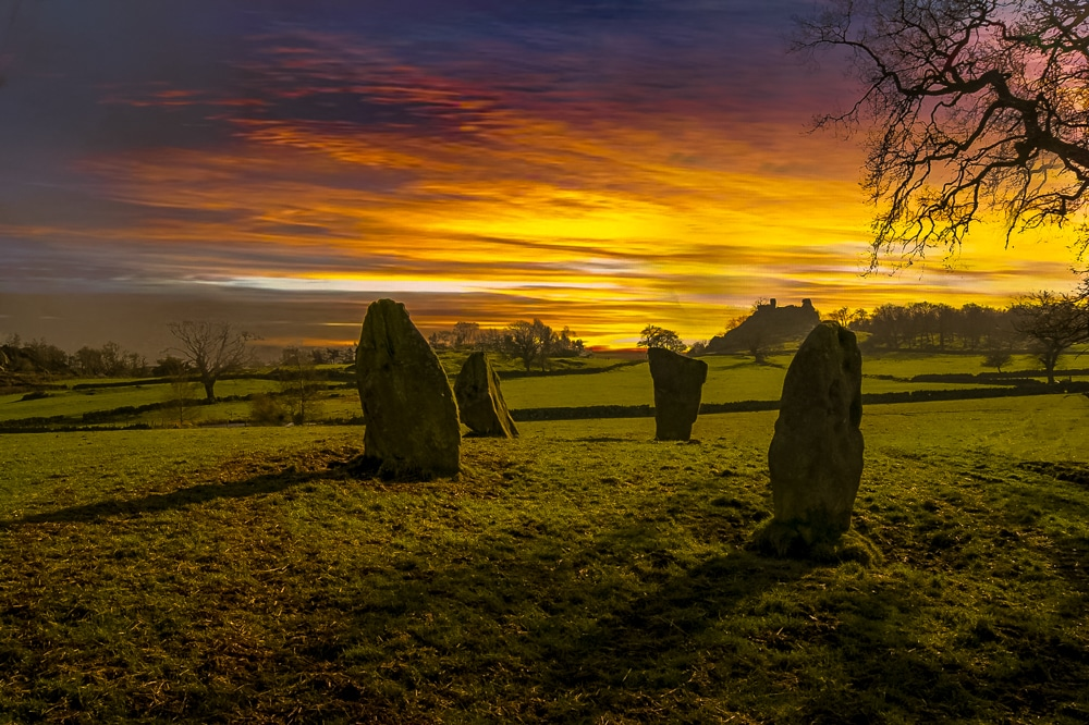 Nine Stone Close Stone Circle with Robin Hood's Stride in the background