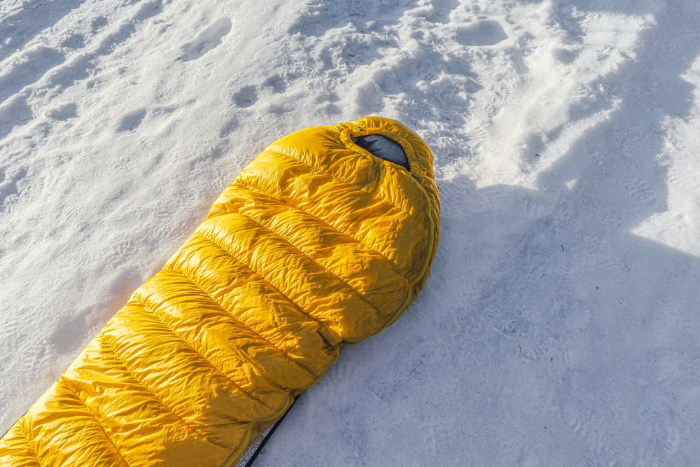 A mummy-spaed sleeping bag in the snow