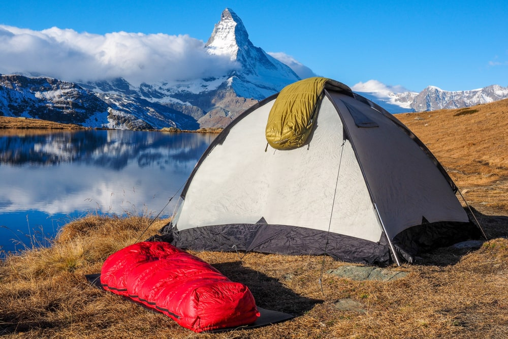 tent pitched near a mountain