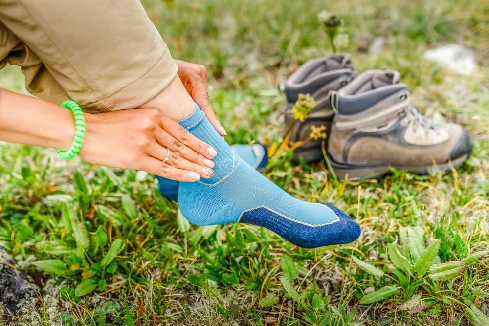a woman rubs her feet