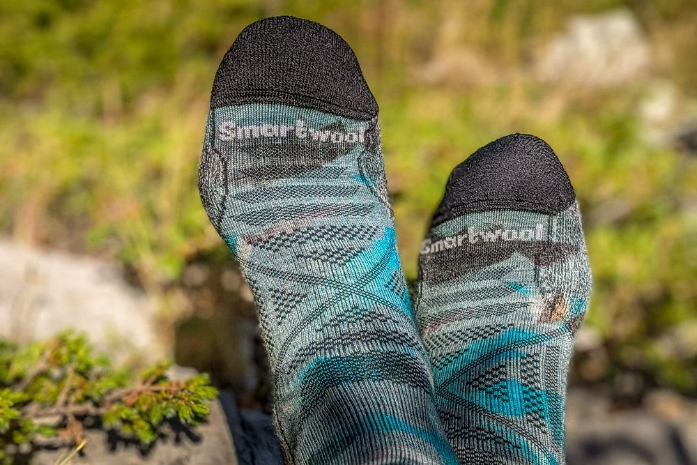 A pair of wool socks help prevent blisters