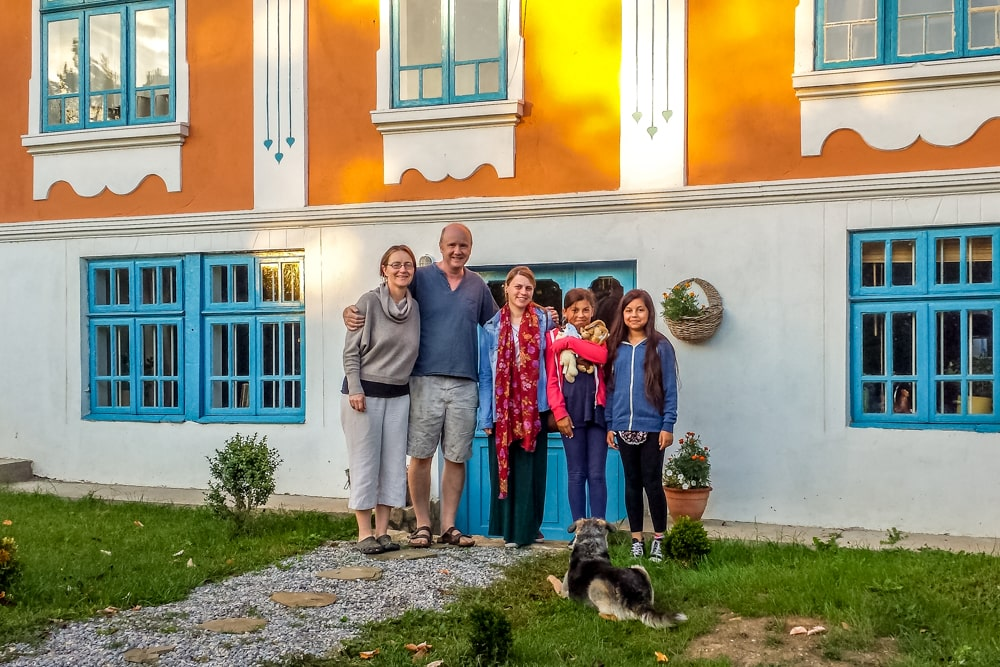 Tharik's family outside the eco-farmhouse with their hosts in Palamartsa, Bulgaria